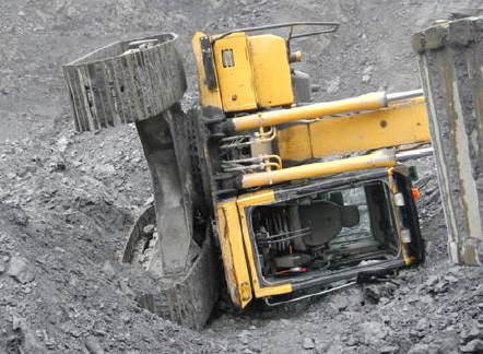 [Image] yellow excavator tipped on side on ore stockpile.
