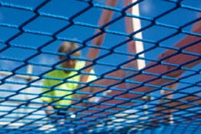 [image] Roof worker seen through underside of knotless square mesh safety net
