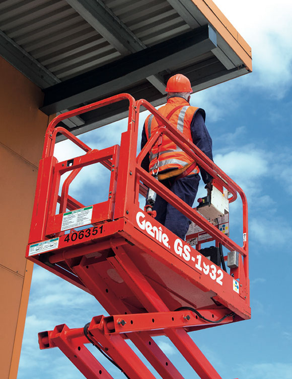 [image] A worker restrained in scissor lift
